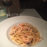 Seafood linguini. It usually comes with a red sauce, but we requested a white cream sauce.