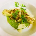leek cannelloni stuffed with vegetable served with shaved Parmesan cheese