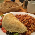 Vegetarian omelette with a side of home fries and rye toast
