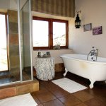 Bathe with a view of the Drakensberg!