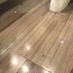 Dirt, stains, marks all over the bathroom floor.