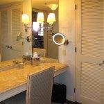 Windsor Court - King Suite bathroom vanity area w/ door to bedroom closed