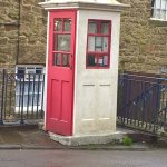 Old telephone box by the tram stop