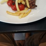 6oz ribeye with sweet tomatoes,bernaise sauce and chips.