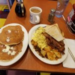 "This is called...""The Ironworker""!!!  3 eggs, bacon, sausage, potatoes, toast and pancakes!!!"