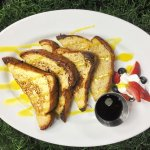 Sharkeez French toast with home made mango couli, fresh berries & maple syrup.