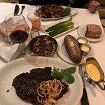 Cowboy Ribeye, asparagus, baked potato, mushroom medley and wine