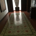 Lift entrance - most floors have some of the original waxed tiles
