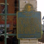 historical sign on the front wall of the DeSoto House Hotel