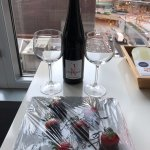 Complementary a bottle of wine and chocolate covered strawberries