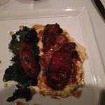 Braised pork shoulder with polenta and sausage