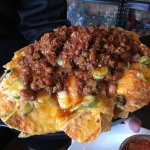 Tap House nachos topped with chili.