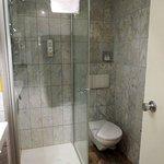 Note liquid soap dispenser in shower