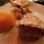 Solomillo con cabrales (tenderloin with blue cheese sauce), served with rice and warm slaw