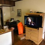 TV situated at end of counter creating obstructed view from couch