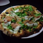 Fig Prosciutto Pizza: arugula, goat cheese, fig balsamic and fresh mozzarella..