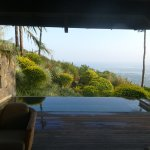 View of the deck, infinity pool and coast from our bedroom