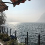 View of Lake Lugano seated by the restaurant
