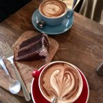 soy milk mocca (red cup), almond milk pumpkin latte (blue cup), vegan chocolate cake