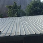 View of metal roof of cafe as seen from my room