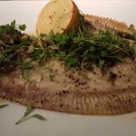 Whole baked Hastings plaice caper and nut-brown butter, late summer herbs