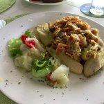 """An excellen""""Saltfish with green figs"""", served in the Yacht. Green figs are actually green banana"""