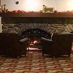 Cozy fireplace on ground level near arcade