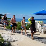 Omar leads guests to the snorkel pier