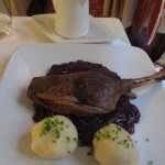 Goose on red coleslaw with dumplings and gravy