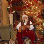 Santa performing at the Inn