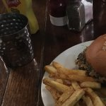 Burger with haggis and whisky sauce and Cajun fries