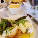 Crabcake Benedict and cheese grits.