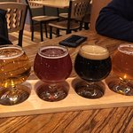 Beer flight - $8. The dark one has a $3 up charge.