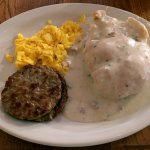 Bill's Special - A fluffy biscuit smothered in delicious old-fashioned gravy, eggs, sausage.