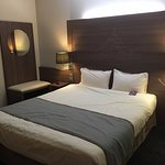 Bed in room 150 at Hotel Mercure Mont Saint Michel