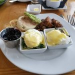 Eggs Benedict with muffin on the side - yummy compote for muffin