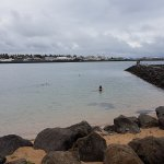 People swimming in the icy cold sea (before going into the hot tub)!