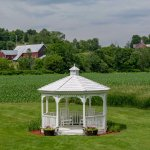 Gazebo on the back lawn with pastoral views.