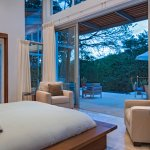 Ix Chex Villas Master Suite overlooking a stunning infinity plunge pool