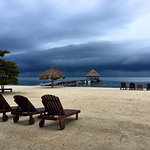Even the rainy days are stunning on the private beach at Xanadu.