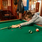 My 9yo learned to play pool!