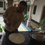 chef giving dhosa cookery demo at breakfast near central courtyard