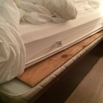 Plywood between mattress and bed...