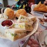 Egg salad sandwich on fresh bread and scones & jam