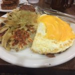Bacon and cheese egg white omelet with hash browns