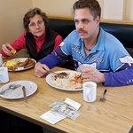 Wife and son enjoying their breakfast
