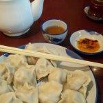 dumplings, spicy sauce, hot tea