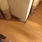 Broken baseboards in room