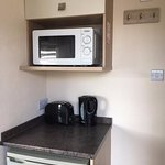 microwave, kettle, toaster and fridge