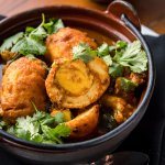 PUNJABI EGG CURRY Cauliflower, Spinach, Cumin Scented Basmati Rice, Cilantro Chutney